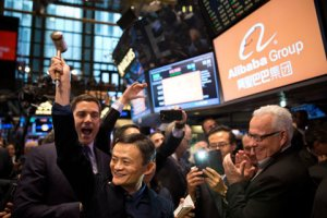 Jack  Ma,  Chief  Founder,  Alibaba,  raising  his  hand.