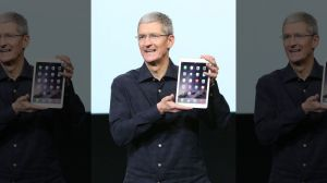 Apple  CEO,  Tim  Cook,  showcasing  the  i Pad  Air 2.