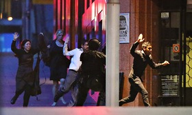 Hostages  running  towards  the  Police.